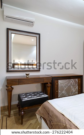 dressing table with large mirror in bedroom interior #276222404
