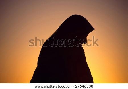 Arab woman with Islamic headscarf in back light #27646588