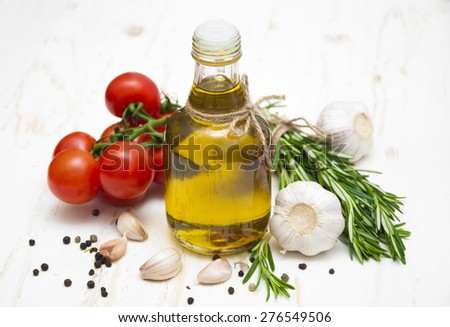 Olive oil, cherry tomatoes, garlic and rosemary on a white wooden background #276549506