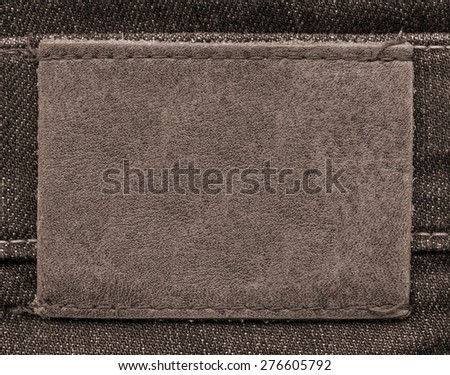 brown leather label on  brown jeans background #276605792