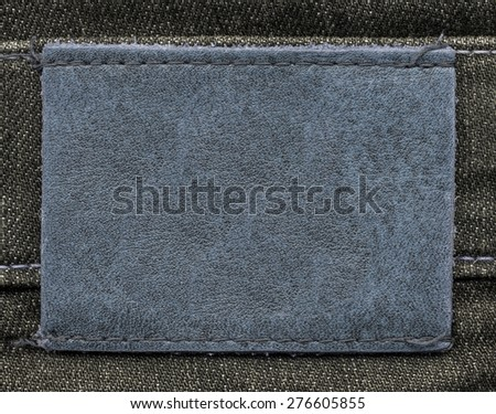 blue leather label on jeans background #276605855
