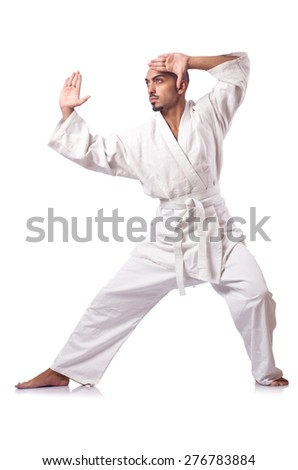 Karate fighter isolated on the white #276783884