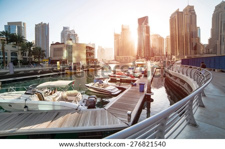 Panoramic view with modern skyscrapers and water pier of Dubai Marina at sunset, United Arab Emirates Royalty-Free Stock Photo #276821540