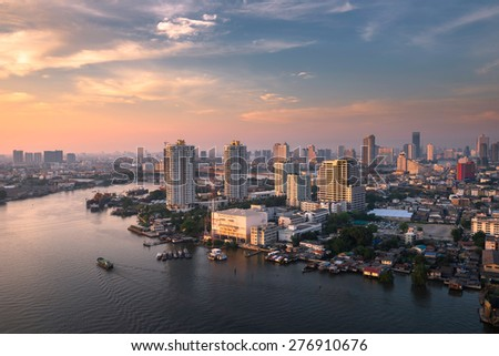 chao phraya river sunset sky, office buildings, living, condominium in bangkok city  skyline top view boat on the river, Downtown and business office bank financial in capital city of thailand asian  #276910676