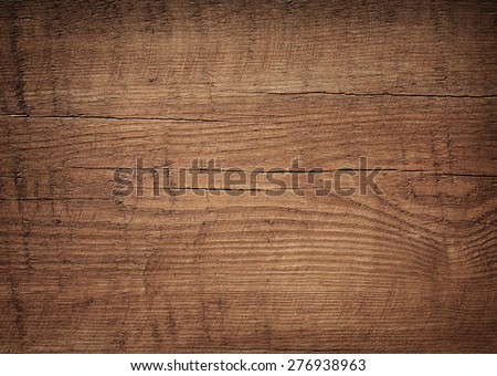 Dark brown scratched wooden cutting board. Wood texture Royalty-Free Stock Photo #276938963