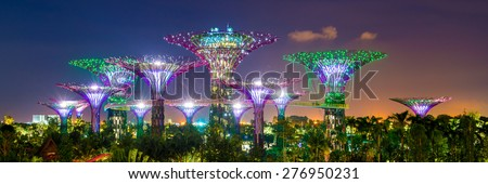 SINGAPORE - APRIL 06: Futuristic view of amazing illumination at Garden by the Bay on April 6, 2013 in Singapore. Night light show at Supertree is main Marina Bay Sands district tourist attraction #276950231