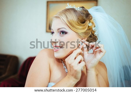 Beautiful caucasian bride getting ready for the wedding ceremony. #277005014