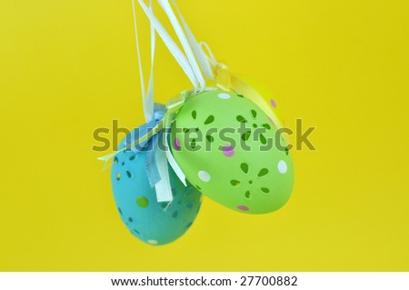 Colorful, beautifully crafted Easter eggs on a yellow background #27700882