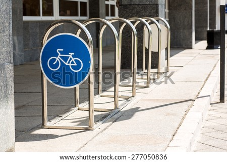 Empty place for a parking of bicycles. Royalty-Free Stock Photo #277050836