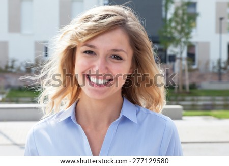 Blond woman in a residential area #277129580