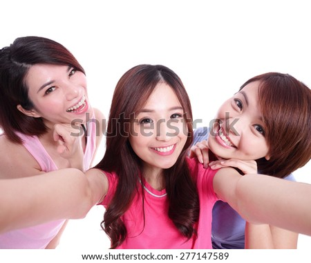 Selfie - Happy teenagers woman taking pictures by themselves isolated on white background, asian