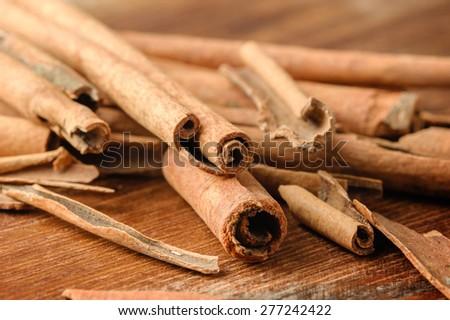 fragrant cinnamon sticks on wooden background #277242422