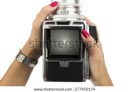 Viewfinder screen on medium format camera with hand holding