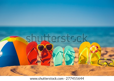Flip-flops, beach ball and snorkel on the sand. Summer vacation concept #277455644