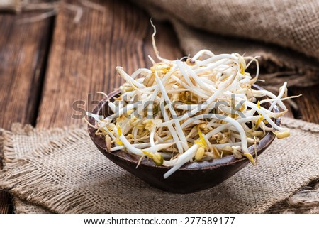 Bowl with Mungbean Sprouts on wooden background #277589177