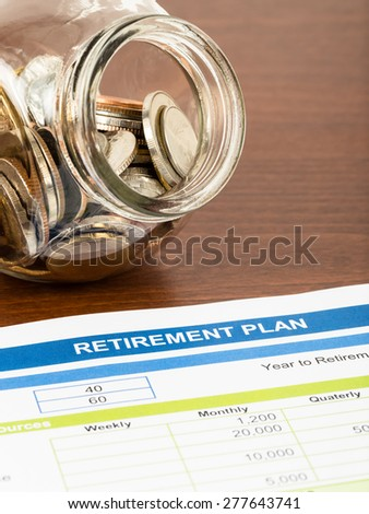 Retirement plan with coin jar; document is mock-up #277643741