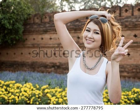 Beautiful Blonde Thai Asian Model Poses in Outdoor Natural Setting #277778795