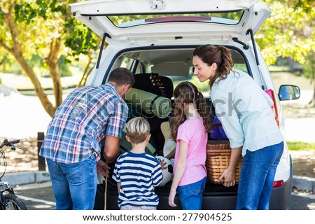 Happy family getting ready for road trip on a sunny day #277904525
