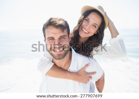 happy couple smiling at the beach #277907699
