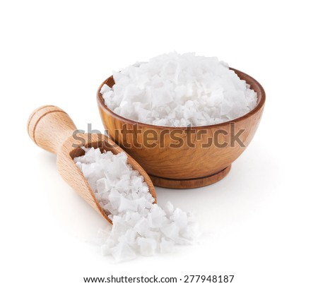 Cyprus sea salt flakes in a wooden bowl isolated on white background Royalty-Free Stock Photo #277948187