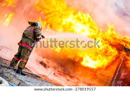 Fireman extinguishes a fire #278019557