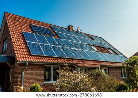 Solar panel on a red roof  Royalty-Free Stock Photo #278061698