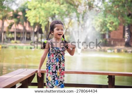 Happy Little girl in a garden #278064434