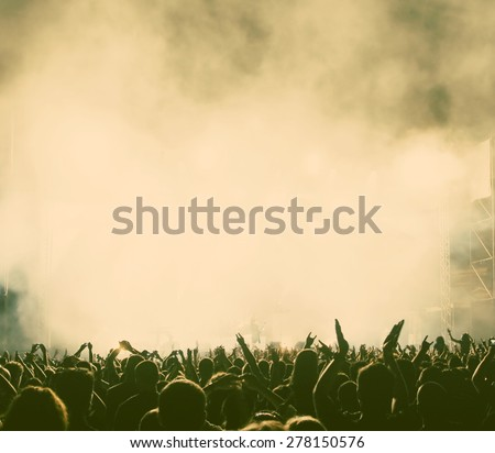 Crowd at concert - retro style photograph Royalty-Free Stock Photo #278150576
