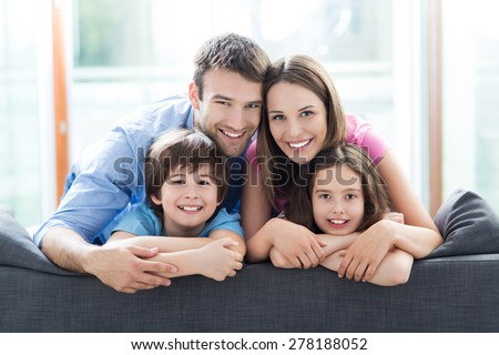 Family relaxing on sofa Royalty-Free Stock Photo #278188052
