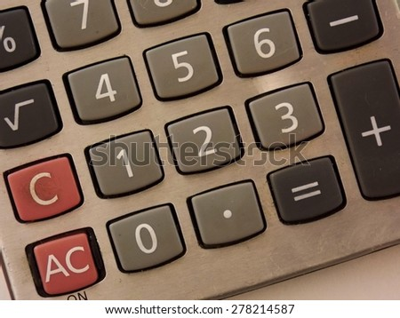 Royalty Free Photograph - Dramatic Close up of the Number Buttons on this Personal Calculator - Isolated