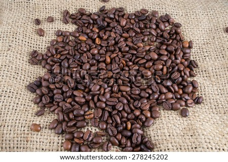 Coffee beans on the canvas background #278245202