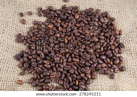 Coffee beans on the canvas background #278245211