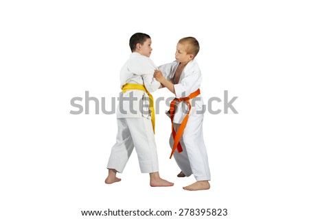 Boys are training Judo techniques against a white background #278395823