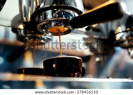 Close-up of espresso pouring from coffee machine. Professional coffee brewing #278456510
