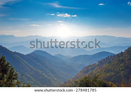 blue color of mountains during sunset  #278481785