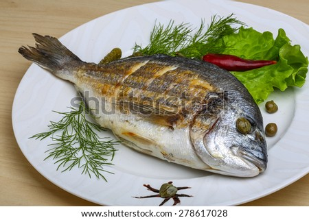 Grilled dorado with salad leaves and dill #278617028