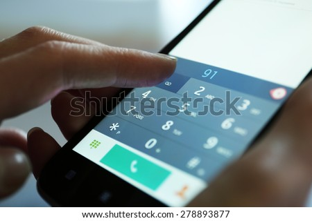 Finger touch number on smartphone to make a call, close up #278893877
