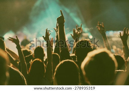 Crowd at concert - retro style photo Royalty-Free Stock Photo #278935319