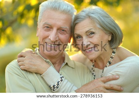 Happy cute senior couple in autumn park #278936153