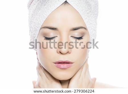 Beauty portrait of a woman with a towel #279306224