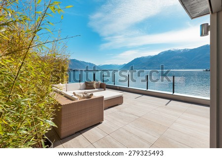modern architecture, beautiful lake view from the terrace of a penthouse #279325493