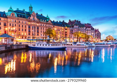 Scenic summer evening panorama of the Old Town (Gamla Stan) architecture pier with sightseeing travel ships and boats in Stockholm, Sweden #279329960