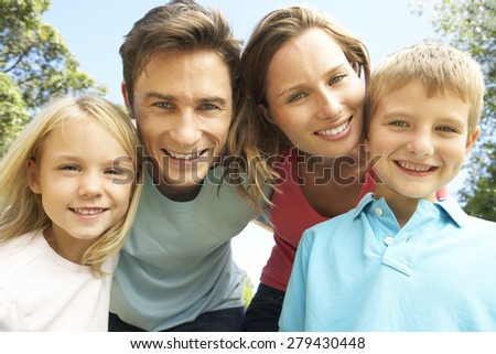 Close Up Of Family Group Looking Into Camera In Park #279430448