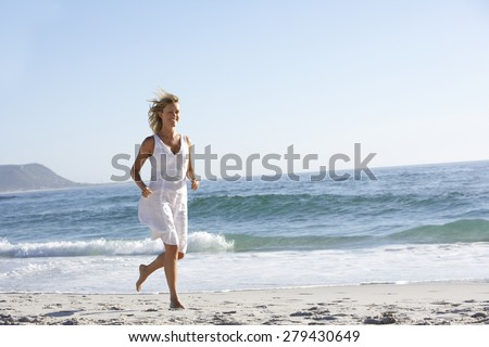 Casually Dressed Young Woman Running Along Beach #279430649