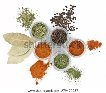 Spices in jars with a bay leaves on a white background  #279472937