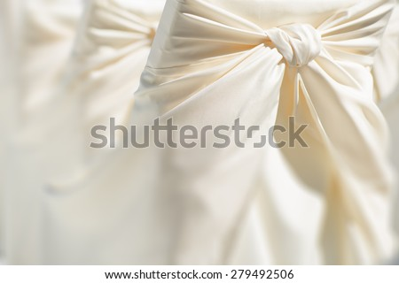 Festive wedding ceremony chair decoration of lightweight white fabric closeup, horizontal picture