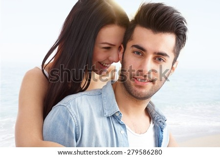 Beach portrait of young attractive loving couple, embracing and smiling happy. #279586280
