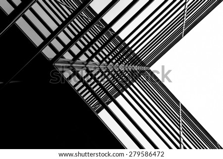 Urban Geometry, looking up to glass building. Modern architecture black and white, glass and steel. X marks the spot. Abstract architectural design. Inspirational, artistic image BW. Royalty-Free Stock Photo #279586472