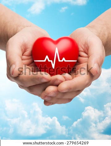 family health, charity and medicine concept - close up of hands holding red heart with cardiogram over blue sky and clouds background #279654269