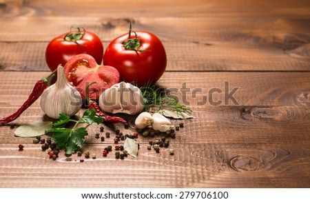 Vegetables and seasonings with on a vintage wooden table #279706100